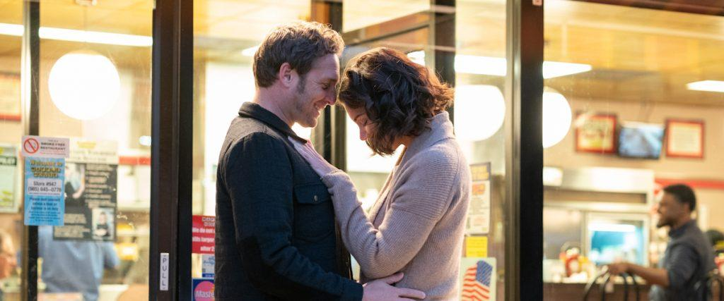 Miranda and Bray embrace in front of a store after unknowingly driving to see each other. After becoming a family-friend to widowed Miranda and her three children, Bray taught the family the basic principles of the law of attraction.