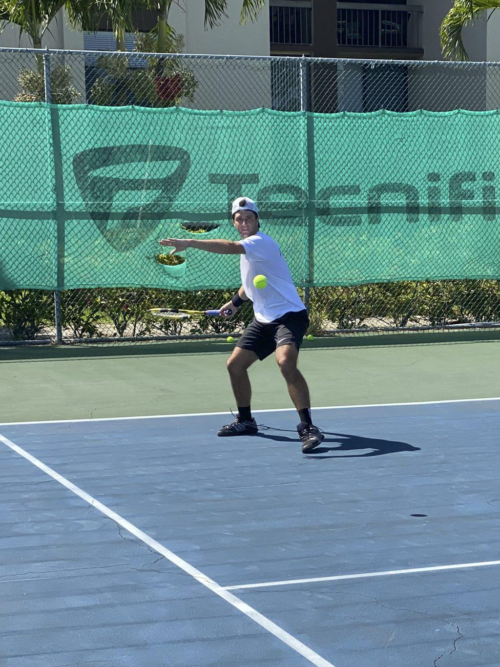 Walk-on freshman Tom Grosjean eyes the ball as he prepares to return the hit to his opponent at Tennium Academy in Delray Beach, Fla. Photo courtesy of Tom Grosjean