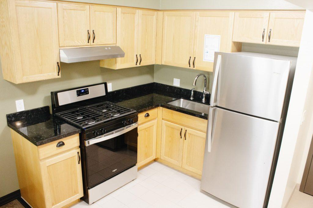 New appliances, cabinets and countertops enhance the updated Lovernich kitchen, photographed Aug. 11. Previously, students complained about old fridges, stoves and countertops.