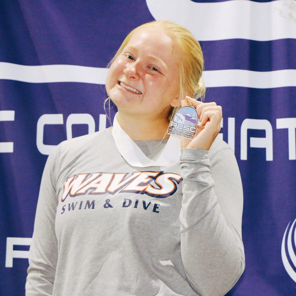 Junior Paulina Holmberg stands with her third-place medal from the Pacific Collegiate Swim and Dive Conference Championships for the 1-meter springboard in February 2020. Holmberg advised sticking to a schedule when looking to solidify a fitness routine. Photo courtesy of Paulina Holmberg