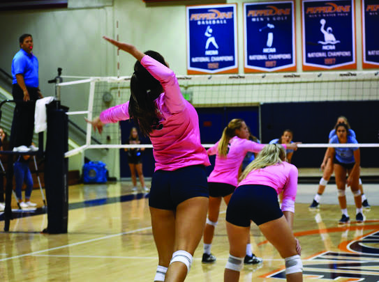 Sophomore Aubrey Roberts serves against University of San Diego opponents in October 2019 at Firestone Fieldhouse. Roberts said her routine this year is pretty similar from day to day: practice, class, homework, rest and repeat. Photo courtesy of Aubrey Roberts