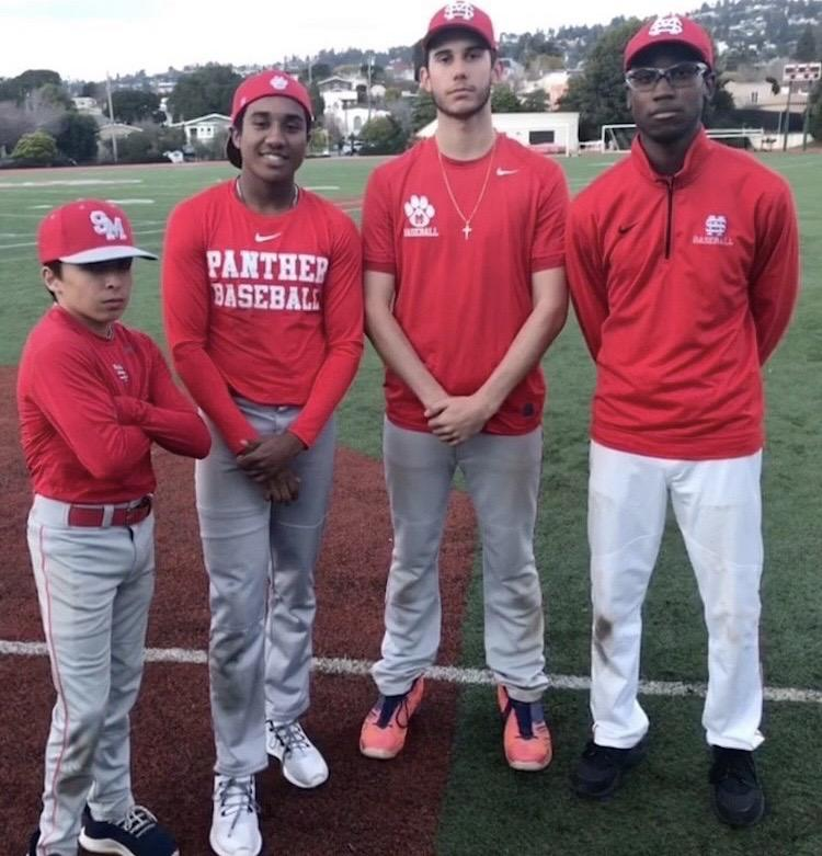 Miles (second from the left) stands on the field for his last time in March while mentoring children with his baseball team. Due to COVID-19, his baseball season was canceled.