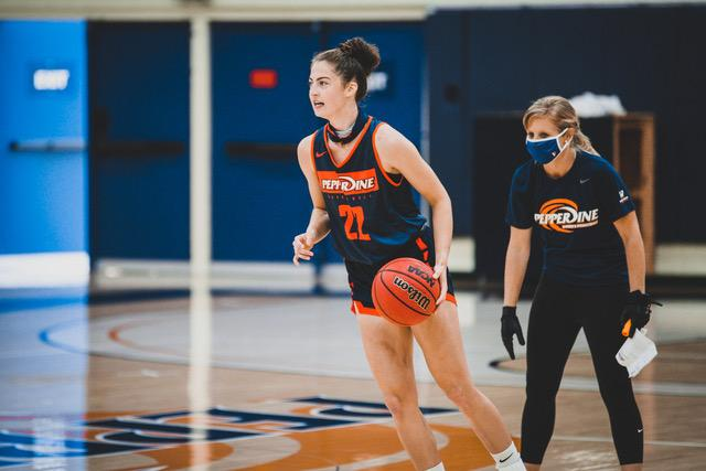 Carson leads a play with direction from Head Coach Kristen Dowling during an Oct. 14 practice in Firestone Fieldhouse. As a senior at Juneau-Douglas High School, Carson averaged 24 points and 8 rebounds per game. Photo courtesy of Pepperdine Athletics