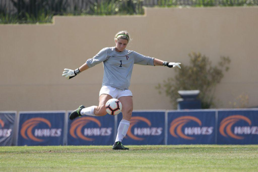 Redshirt junior goalkeeper Zoe Clevely bumps the ball with her knee in a victory game over UC Riverside on Aug. 22, 2019. In her first year starting, Clevely went down with an injury during the fourth game of the season versus Vanderbilt but is expected to return to her starting spot.