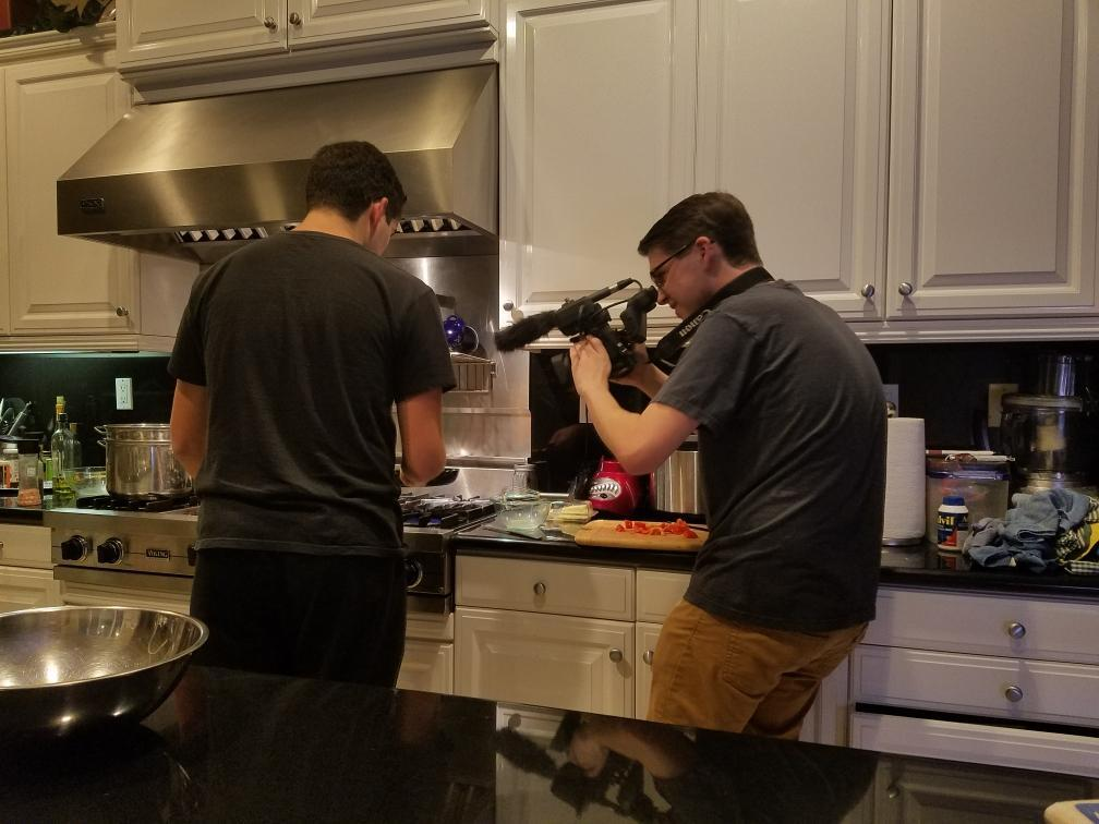 """Emrich films his friend cooking for his """"The Perfect Omelette"""" project in the summer of 2019. Emrich said combining his music-related passions starts his filmmaking process."""