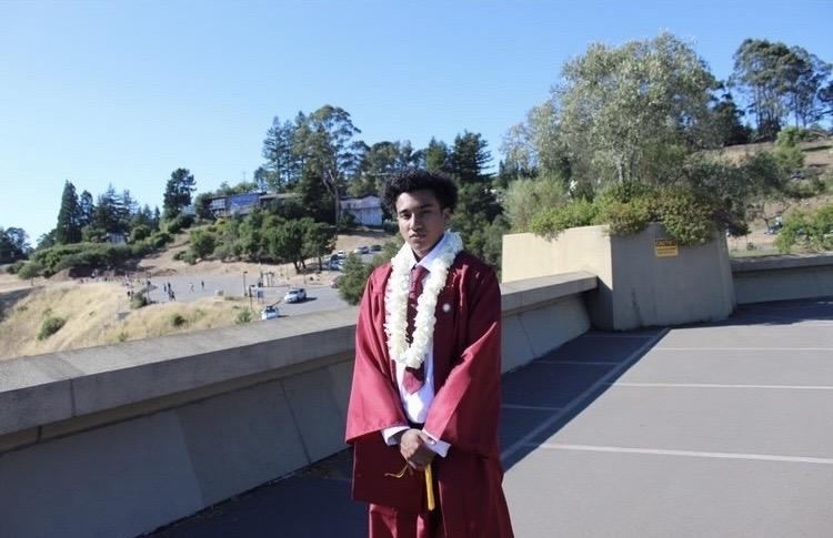 Miles poses in his maroon cap and gown for his graduation pictures at the Lawrence Hall of Science in Berkeley, CA, in June. At Pepperdine, he said he is hoping to learn as much as he can about psychology.