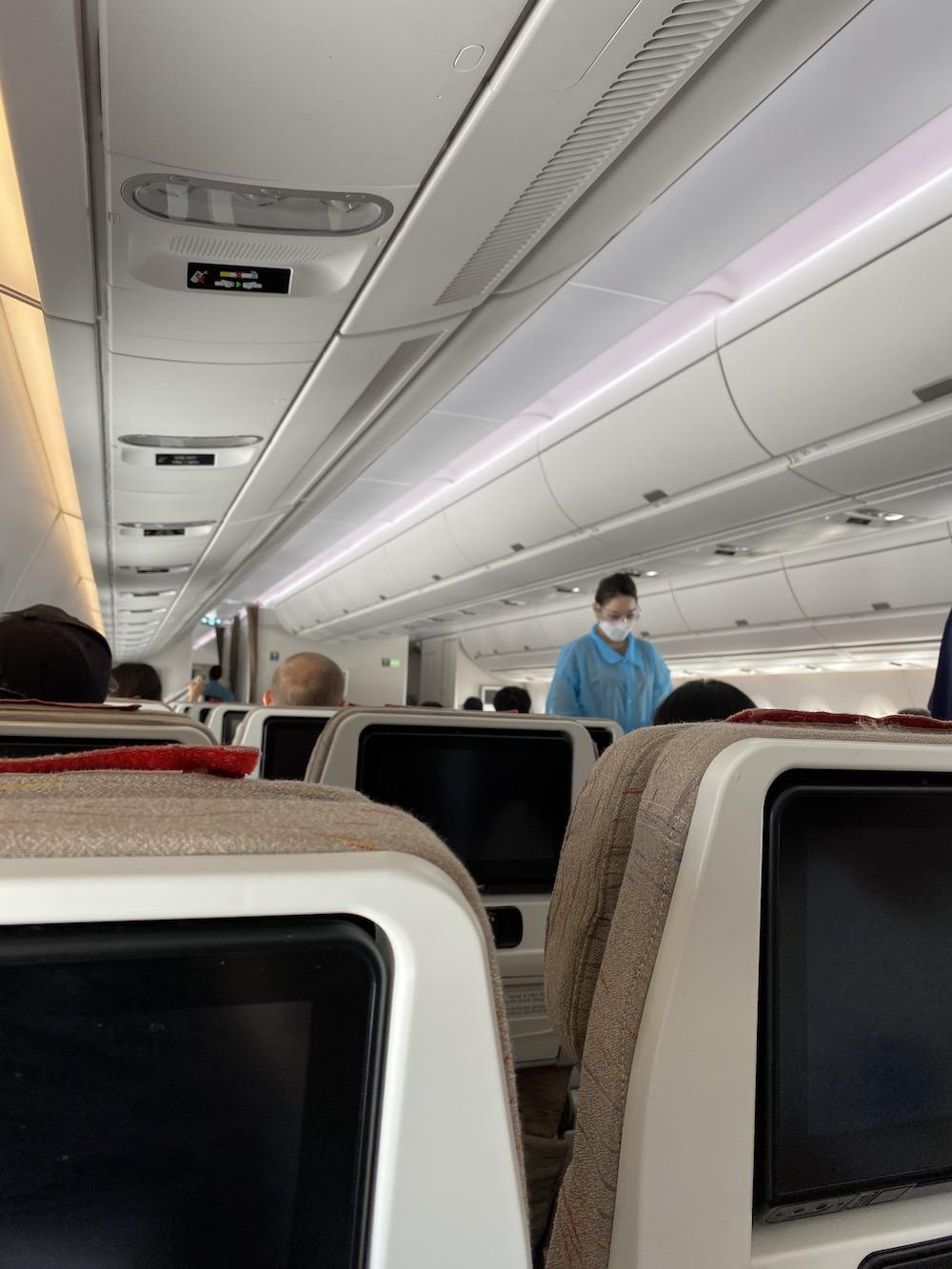 Flight attendants ensure passengers properly prepare for take-off. The biggest difference between this flight and pre-COVID-19 flights was the use of personal protective equipment.