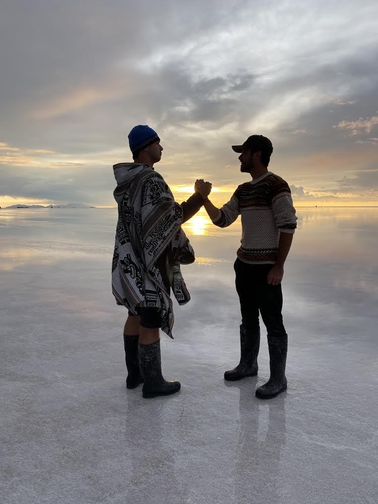 Jacob Erbes and Ekenstam visit the largest salt flats in the world in Uyuni, Bolivia, during their travel break from the BA program in February. Erbes said he loves to post pictures from his time abroad on the club's Instagram, especially since the club cannot take any in-person photos. Photo courtesy of Jacob Erbes