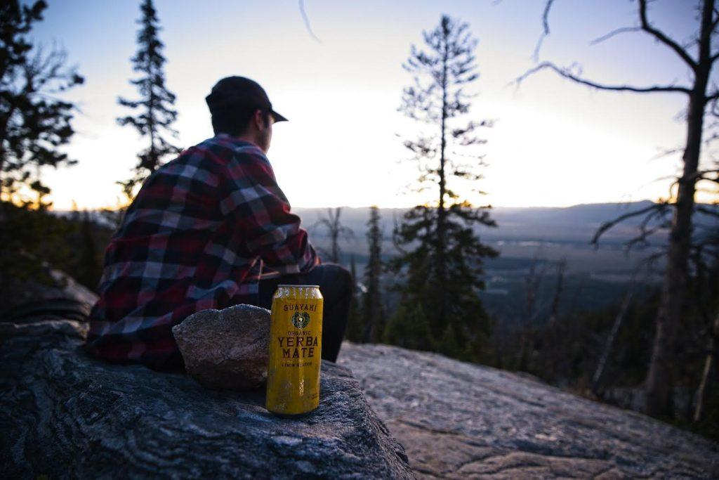 Erbes gazes at the view from Delta Lake under the Grand Teton in Jackson, Wyo., while he sips Guayaki Herba Mate in September. Erbes said Guayaki's mission is to share the cultural and social implications of the sacred South American drink. Photo courtesy of Jacob Erbes