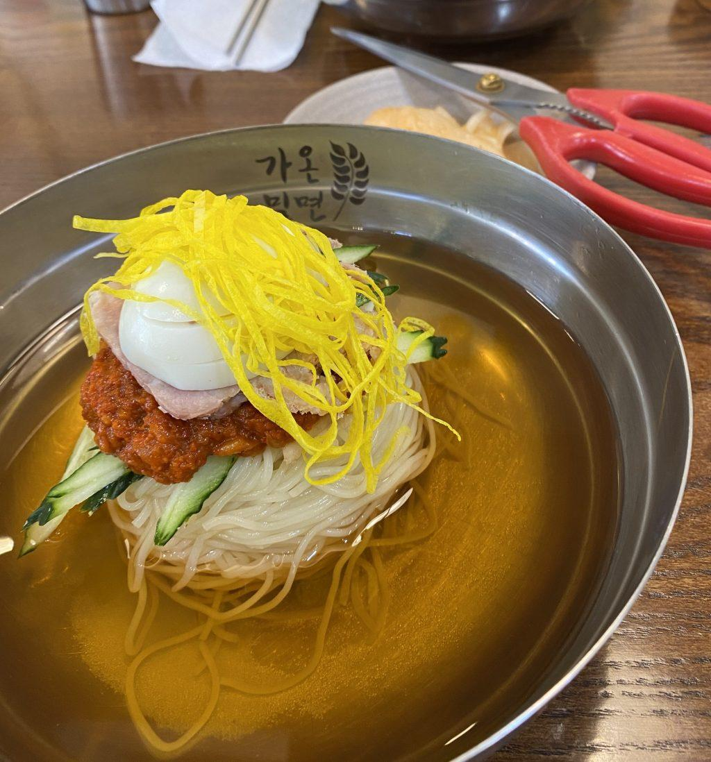 I ate delicious milmyeon soup, made with string-style eggs on top of a boiled egg, meat, spicy sauce, cucumber and milmyeon noodles, at Gaon Milmyeon on Oct. 5. This dish was typically served cold with a cup of warm tea or small soup on the side.
