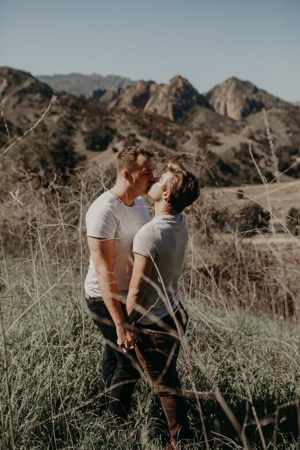 Knight and Clayton kiss in the mountains at Malibu Creek State Park for their engagement photos in February. Knight said they hope to inspire acceptance for all queer people and normalize the queer community in society.