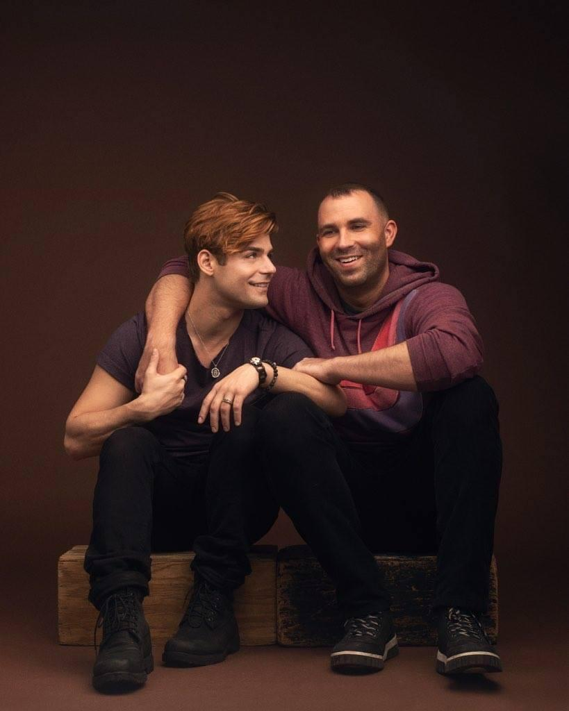 Knight and Clayton smile at each other for a photo taken by Luke Fontana in early 2018. After dating for almost eight years, Knight said this was one of the couple's first shoots after coming out.