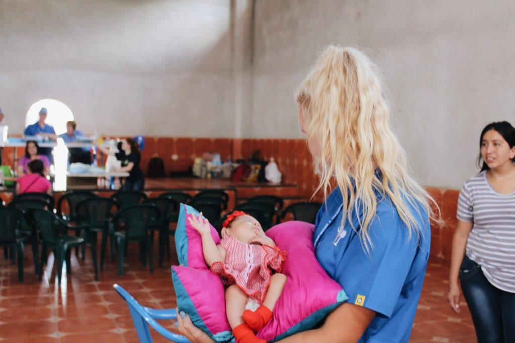 Wisniewski cradles a child during her trip to Honduras as a medical brigade volunteer in 2017. She participated in this program for three years in a row through Mission UpReach, a humanitarian relief organization.