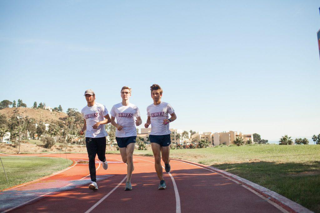 Freshmen Nate Lannen, Ryan Hemphill and Lerch do a quick shakeout run at the Stotsenberg Track on Oct. 27. The three runners live in the Lovernich Apartments on campus. Photo by Jaylene Ramli