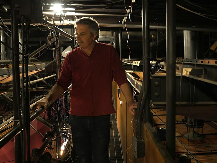 Assistant Technical Director Stewart O'Rourke stands on the catwalk above Smothers Theatre on March 2 from where he believes a mysterious clapping originated one night in the late 1980s. When workers checked, there was no one there. Photos by Kaelin Mendez