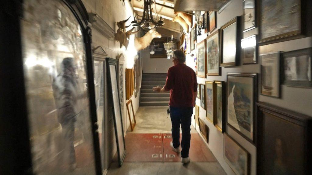 O'Rourke walks down the prop-laden hallway that provides access to Smother Theatre's control booth March 2. In the early 2000s, students claimed to see a white image at the end of the hall.