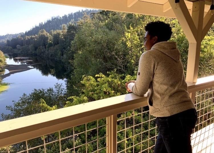 Alone with his thoughts on a fall retreat, Miles looks over Russian River in Santa Rosa, CA, in November 2019. In Miles' high school, every senior went on a retreat to understand themselves on a deeper level.