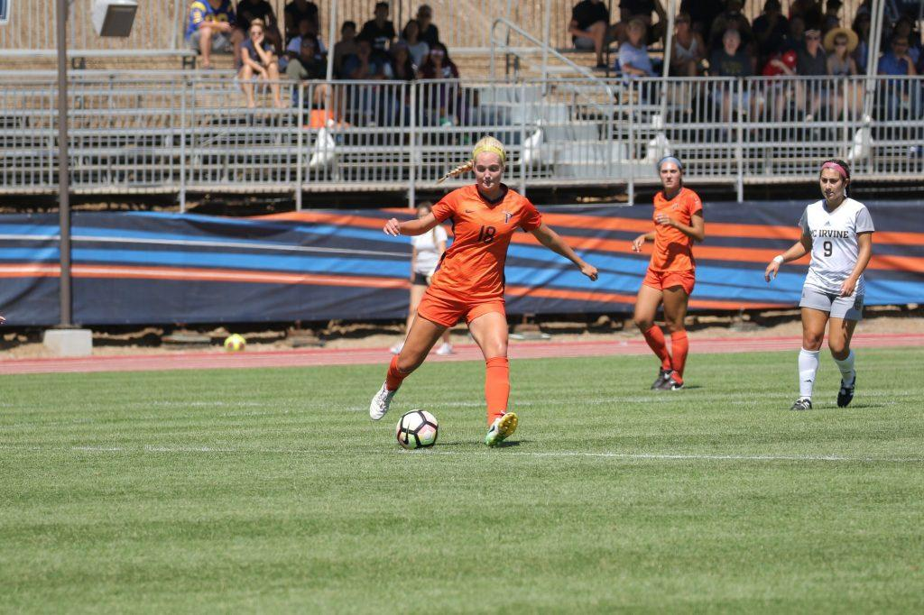 Senior defender Emily Sample boots the ball in a Sept. 16, 2018, game against UC Irvine. The Waves won the match 2–0.