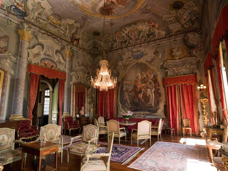 The living room in the Chateau d'Hauteville remains in the 18th-century style. Pepperdine finalized the purchase of the chateau in 2019. Photo courtesy of SwissCastles.ch