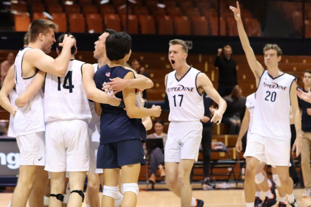 Men's Volleyball (from left to right: JT Ardell, Alex Gettinger, Noah Dyer, Diego Perez, Mason Tyler and Austin Wilmot) celebrates overcoming a two-set deficit to defeat Concordia University Irvine on Feb. 12 at Firestone Fieldhouse. All players but Dyer have planned to return for the upcoming season. File photo