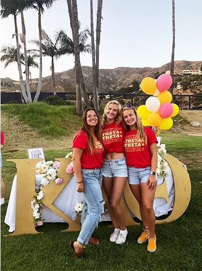 Senior Thetas Ally Richards, Shaeli Funk and Catt Ott (left to right) prepare for the 2019 Meet the Chapters event on the Pepperdine Intramural Field. Panhellenic Recruitment events shifted to an online format this semester, which led to a reduced number of potential new members attending Recruitment. Photo courtesy of Ally Richards
