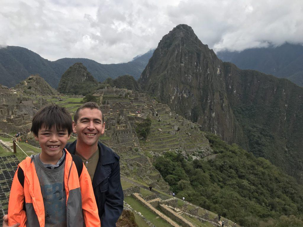 Swarts smiles with Shosuke at Machu Picchu during the fall 2020 International Study Tour to Peru. Swarts said canceling this summer's trips with his family was hard because he loves to travel.