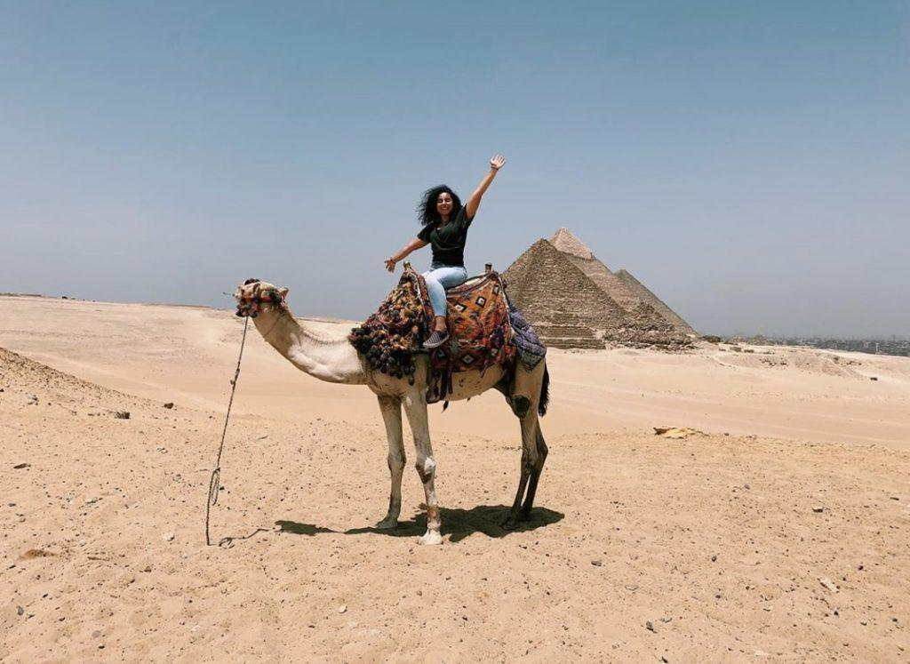Tadros explores the pyramids in Cairo, Egypt, by camel in June 2019. Tadros' family is from Egypt, and Tadros visited the country for her first time last summer.