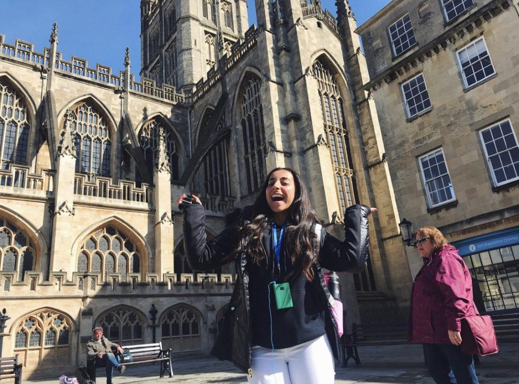 Tadros smiles in front of Bath Abbey cathedral in Bath, England, in April 2018. Tadros' high school choir group traveled to Europe every two years and performed in churches and cathedrals.