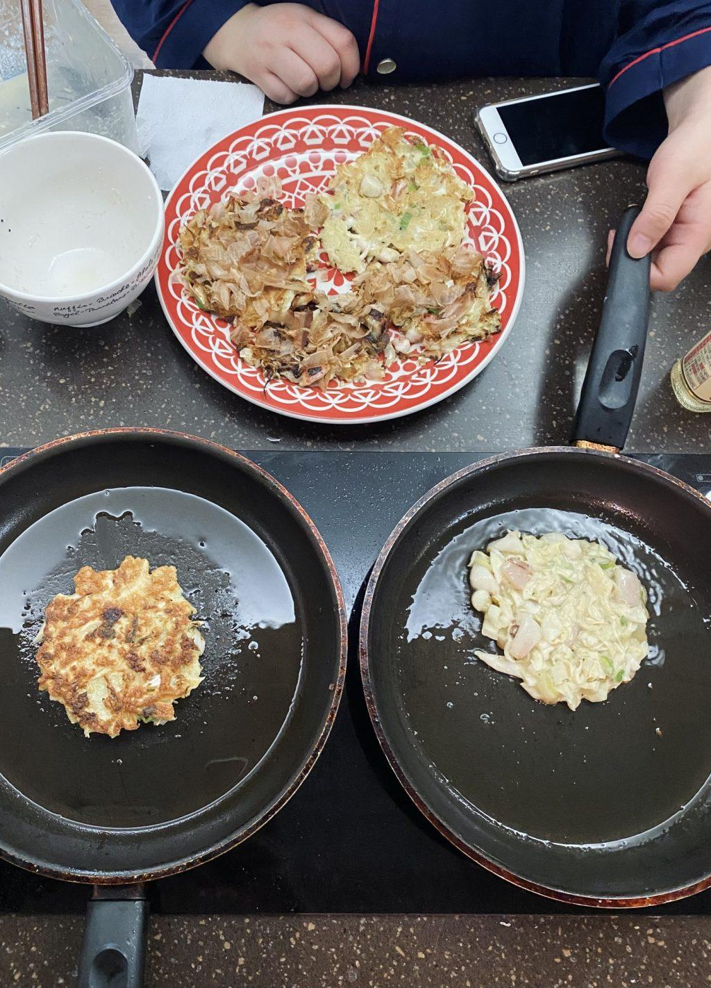 Grace Lee, a senior Chemistry major at Sangmyung University, and I cook Okonomiyaki on a kitchen stove Sept. 19. This was the second time I cooked with another housemate, and it was the beginning of a new friendship.
