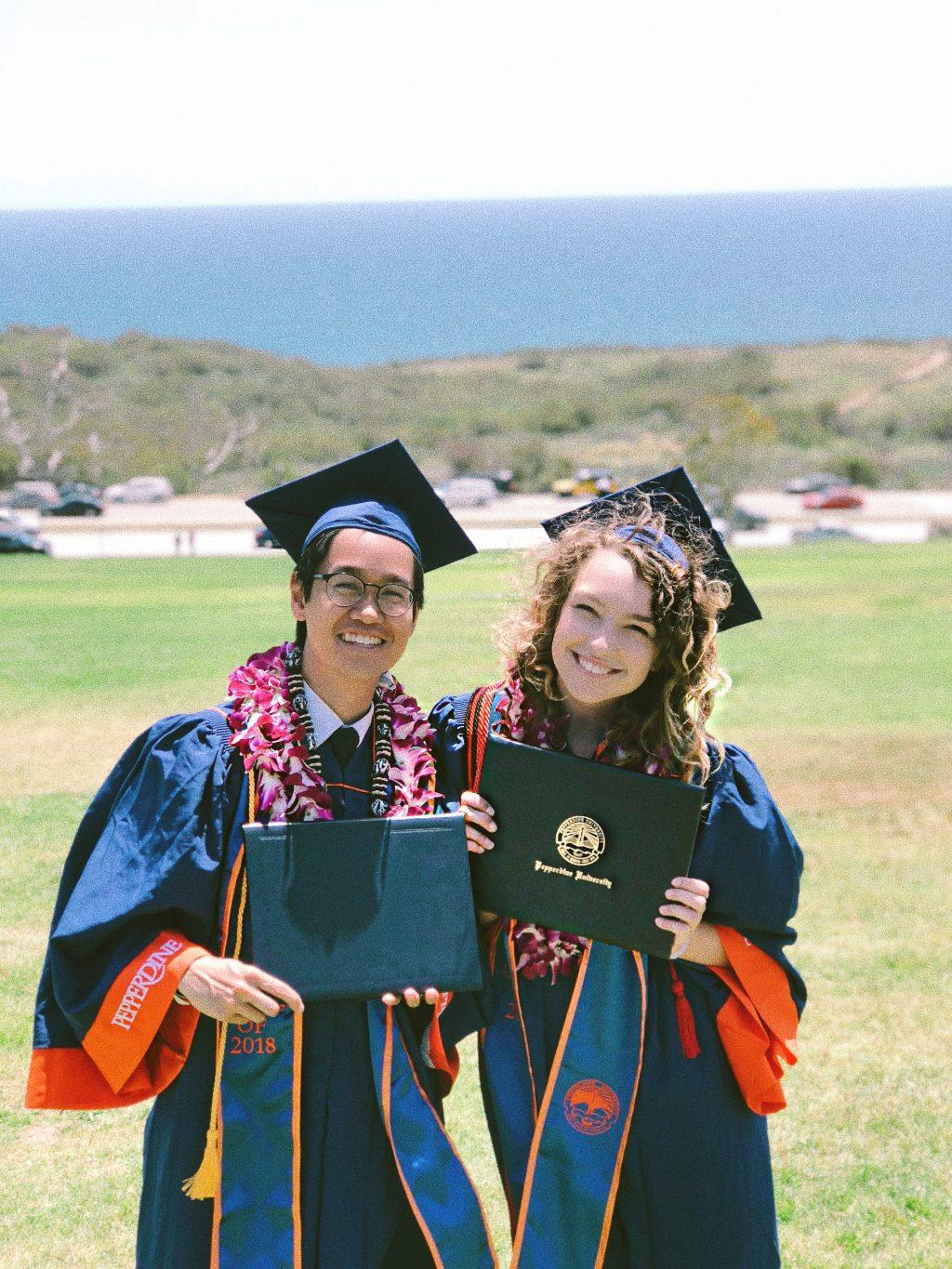 Alumni Justin Lew and Elizabeth Hanley hold their diplomas in front of the Pacific Ocean after graduating from Pepperdine in April 2018. The pair originally started out as friends, but now they have been dating for three years. Photo courtesy of Elizabeth Hanley