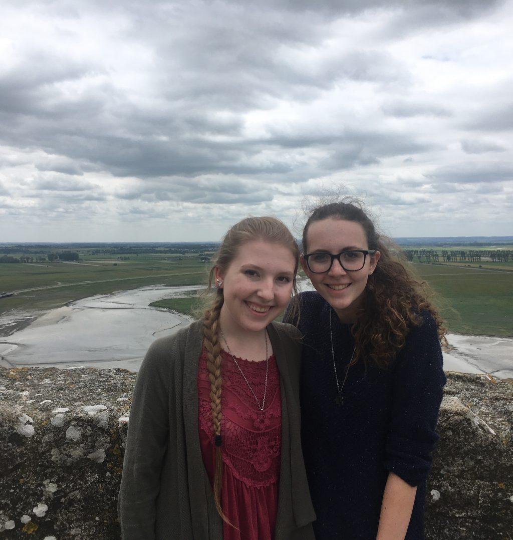 Thompson and Miller pose for a picture in Northern France during their senior trip in 2018. They said they have traveled a lot since. Photo courtesy of Katie Thompson