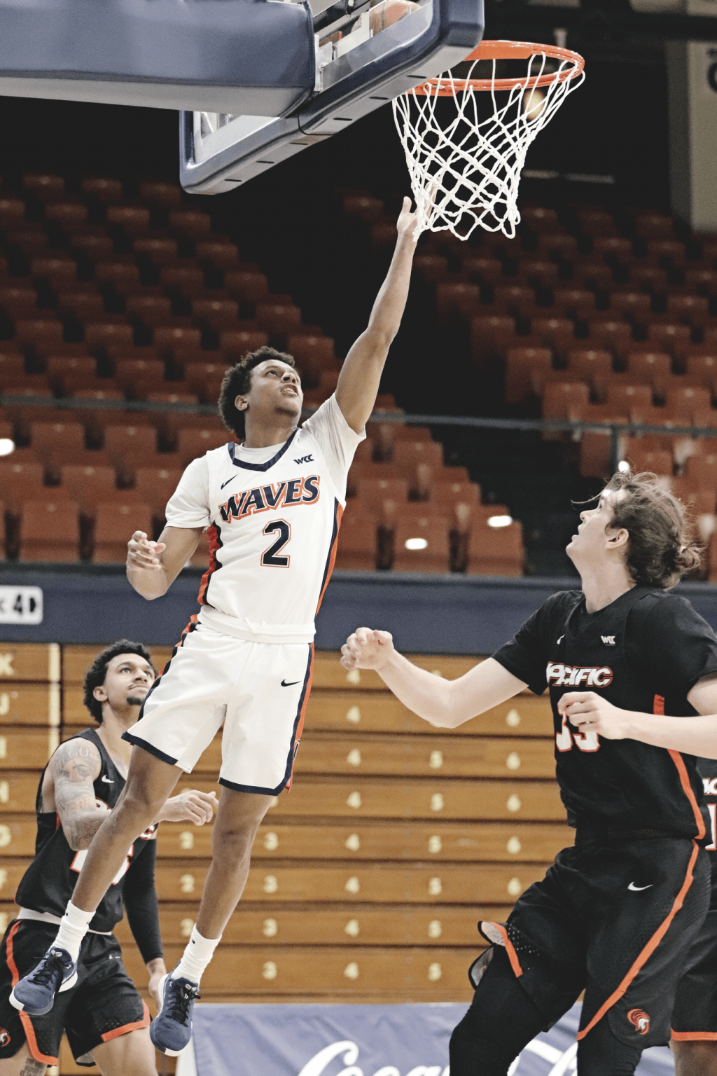 Junior guard Darryl Polk Jr. extends for a soft layup at the rim during the second half.
