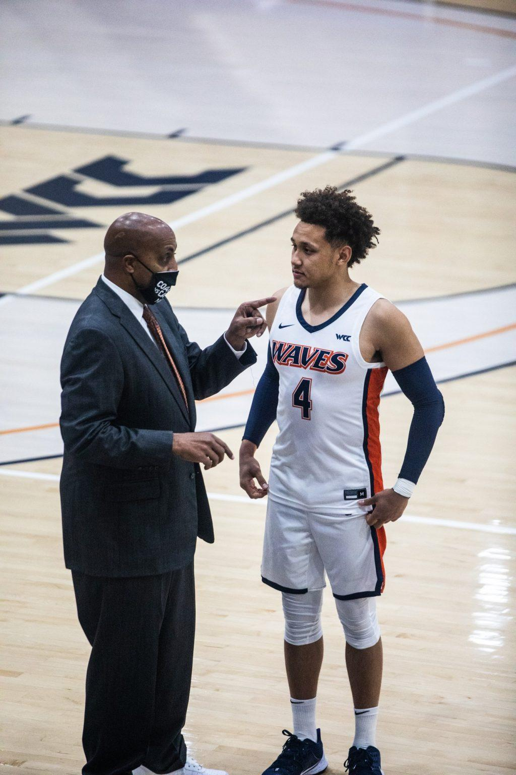 Head Coach Lorenzo Romar instructs Ross during BYU free throw attempts. Ross stuffed the stat sheet with 19 points, 7 rebounds, 6 assists and 2 steals.