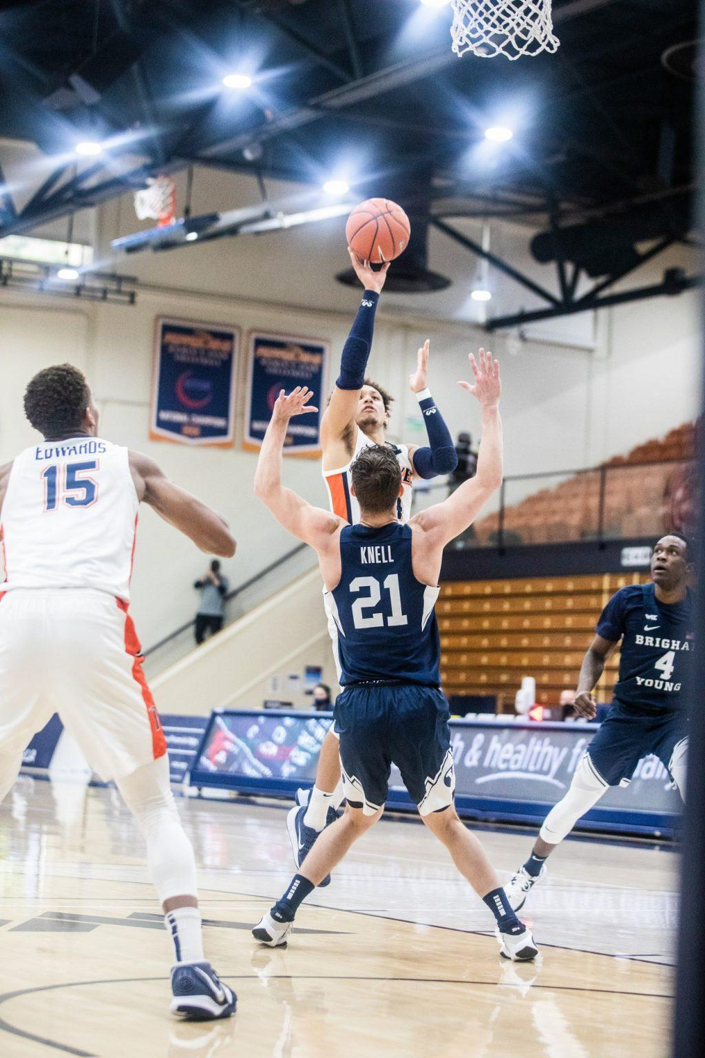 Ross shoots a right-handed floater in the paint as BYU sophomore guard Trevin Knell (No. 21) attempts to take a charge. Ross finished 4-17 from the field but shot 11-13 from the free-throw line.