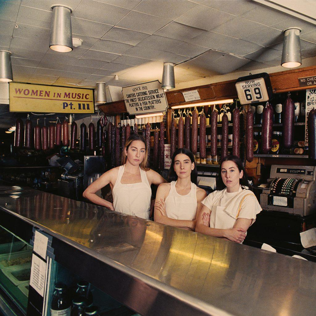 "Sisters Este, Danielle and Alana Haim stand in Canter&squot;s Deli in Los Angeles. ""Women in Music: Pt. III"" was the group&squot;s third studio album, and they were nominated for Best New Artist in 2015 at the Grammys. Photo courtesy of haimtheband.com"