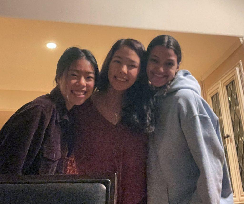 First-year students Annie Leow, Annette Im and Nayeli Castillo smile in their Malibu apartment Feb. 13. Many students moved to the Pepperdine area to find community after the University announced plans to begin the spring 2021 semester virtually. Photo courtesy of Annette Im