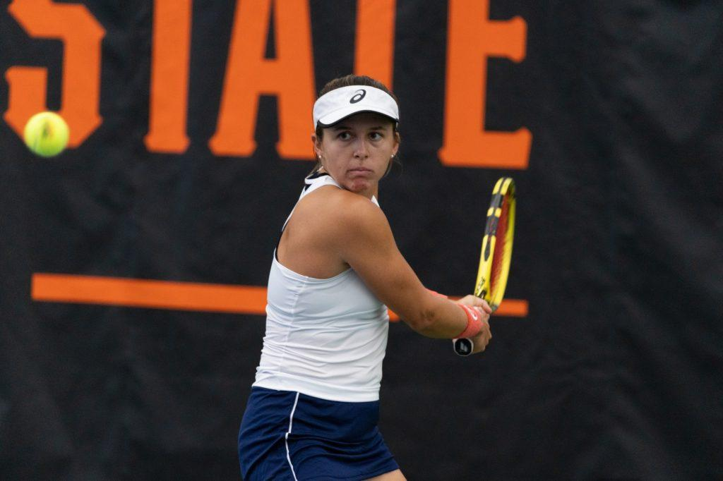 Freshman Nikki Redelijk readies to strike a backhand against Georgia Tech's Rosie Garcia Gross in their singles match Feb. 5 at Oklahoma State University. Redelijk won the match in three sets to clinch the match for Pepperdine.