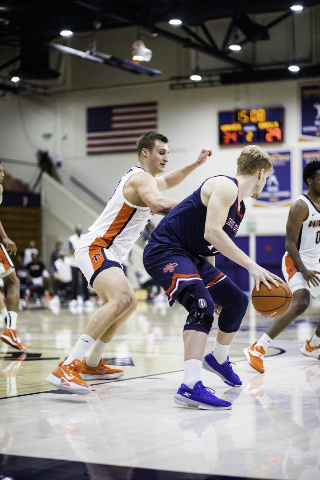 Sophomore forward Jan Zidek plays defense as Saint Mary's junior center Matthias Taas backs him down. Zidek was effective off the bench with 11 points and 11 rebounds.