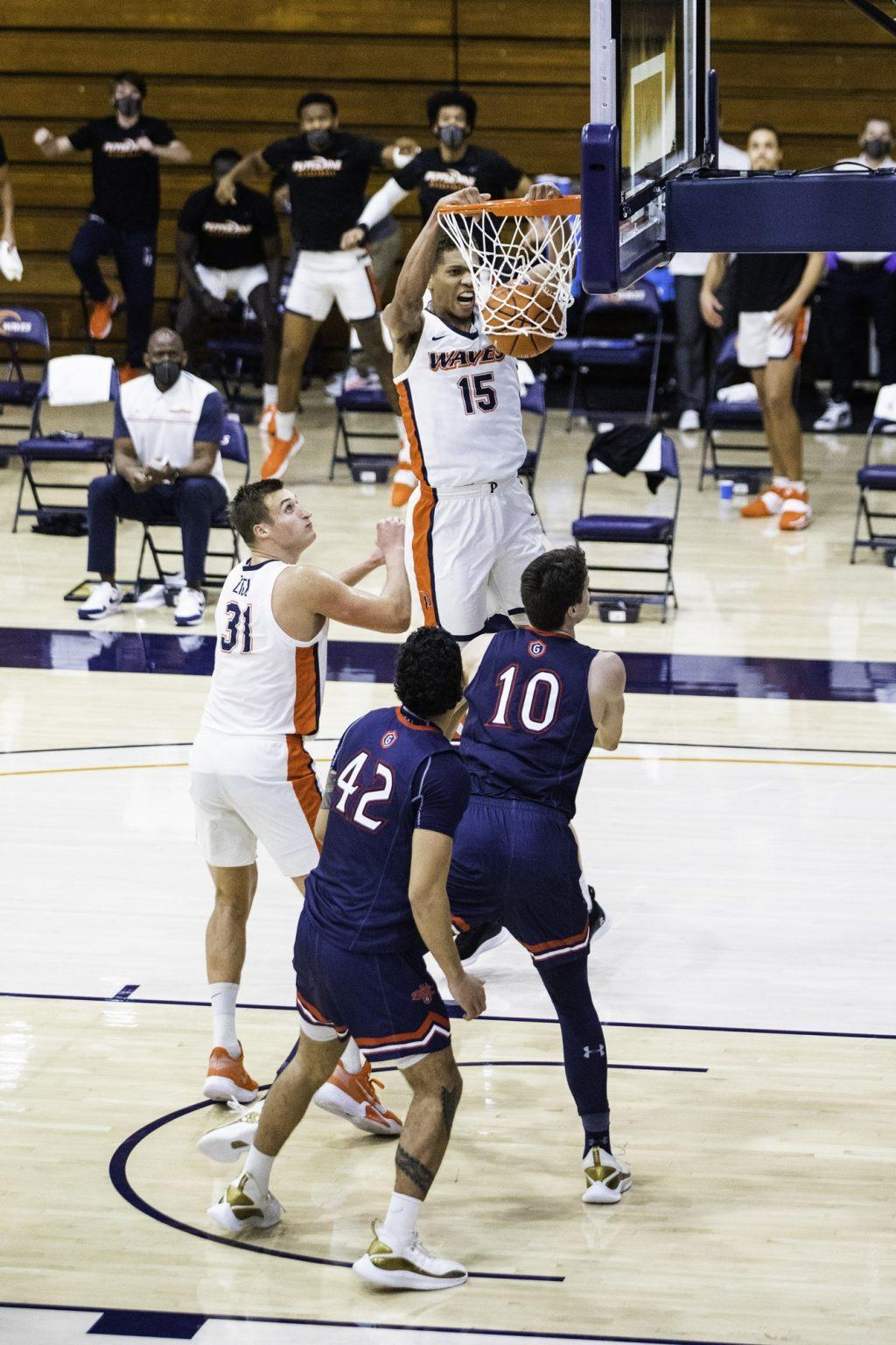 Edwards goes up for a two-handed jam in the second half. Of Pepperdine's 60 total points, 22 of them came from inside the paint.