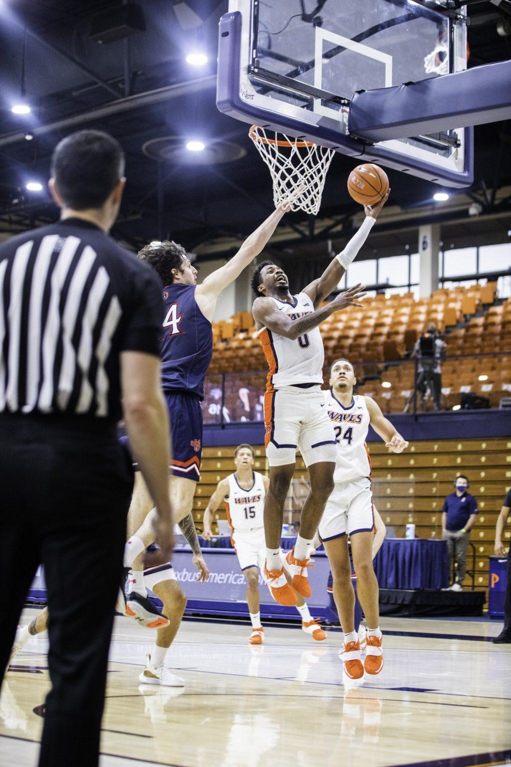 Sophomore guard Sedrick Altman finishes a layup with the left-hand. While he had nine points, his biggest impact was on defense with two steals and two blocks.