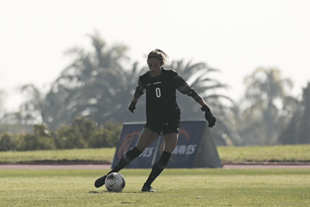 Redshirt sophomore goalkeeper Kinsey Ehmann clears the ball against UCLA at Tari Frahm Rokus Field on Feb. 7. Ehmann recorded a save in the loss to the Bruins.