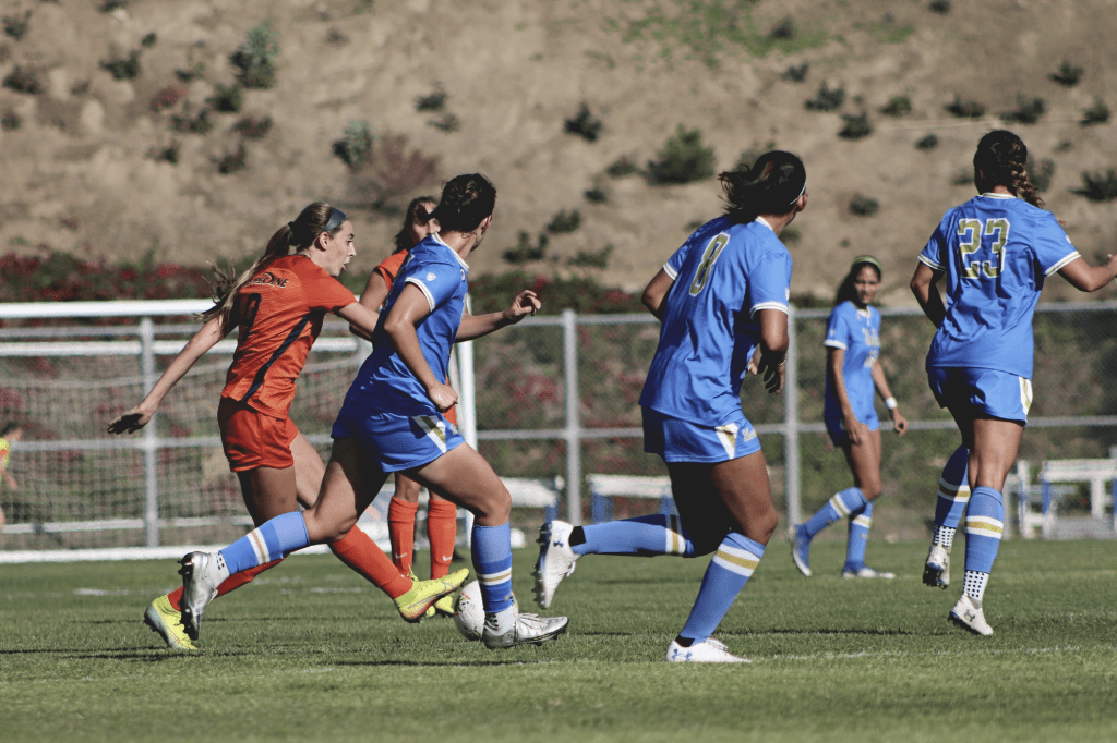 Senior midfielder Joelle Anderson (No. 9) attacks the UCLA defense in the Waves' season opener at Tari Frahm Rokus Field on Feb. 7. Anderson was recently drafted by the Houston Dash in the NWSL Draft.