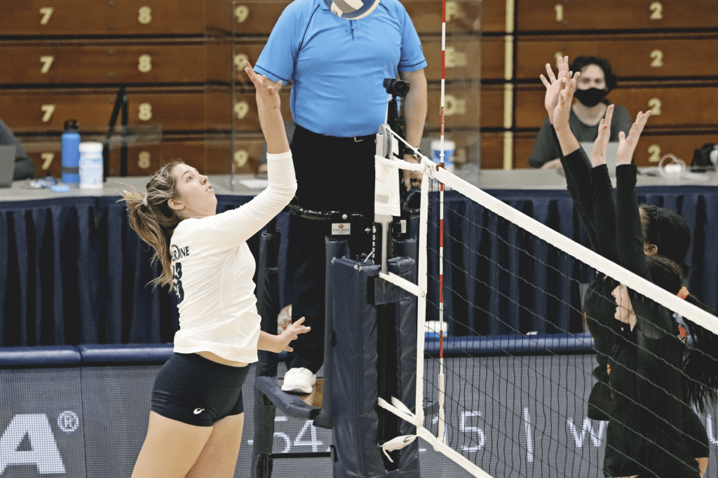 Outside hitter Rachel Ahrens launches up for a tip against awaiting Pacific blockers. Ahrens recorded 11 kills against the Tigers.