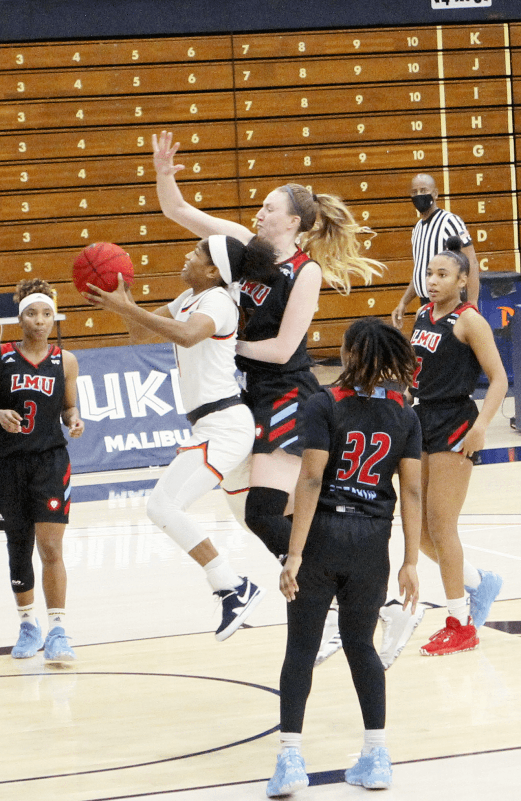 Junior guard Cheyenne Givens drives the lane against LMU's Megan Mandel during Saturday's win. The Waves survived a second half Lions comeback to notch their first WCC win of the season.