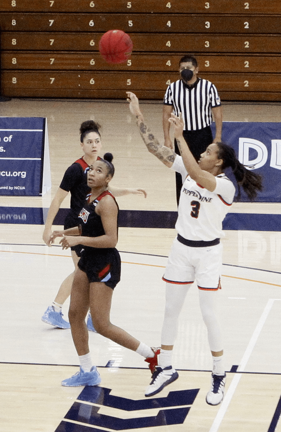 Redshirt sophomore guard Jayda Ruffus-Milner pulls up from midrange during Saturday's game against LMU. The Waves shot 37% from the field and crucially out-rebounded the Lions 45-30.