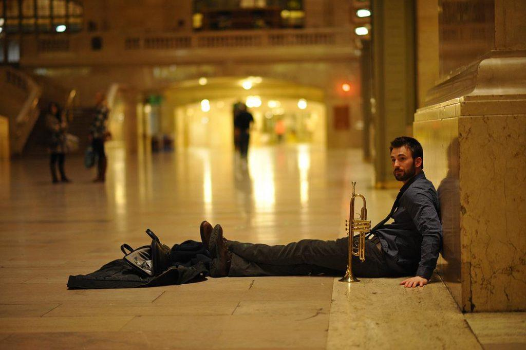 Nick plays the trumpet in Grand Central Terminal at 1:30 a.m. where he notices Brooke. This moment marked the start of their adventure in the city.