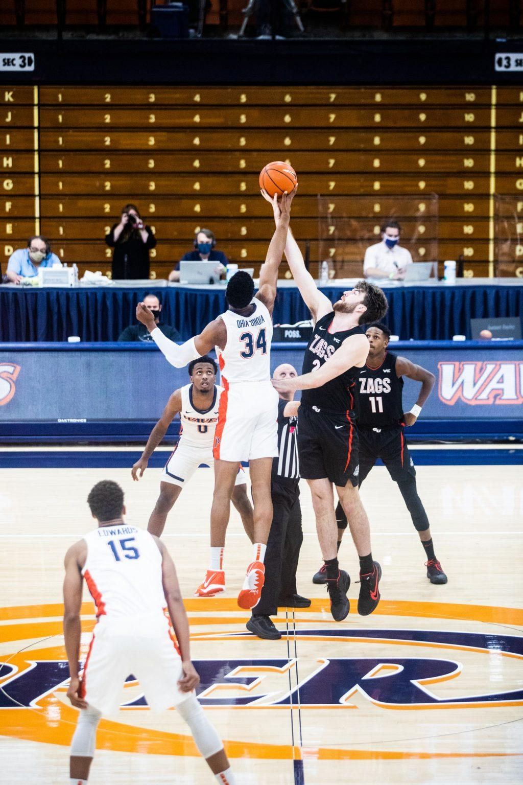 Junior center Victor Ohia Obioha wins the tipoff against Gonzaga's Drew Timme at the beginning of Saturday's game in Firestone Fieldhouse. Pepperdine got off to a hot start in the game, leading 16-7 after the first five minutes.