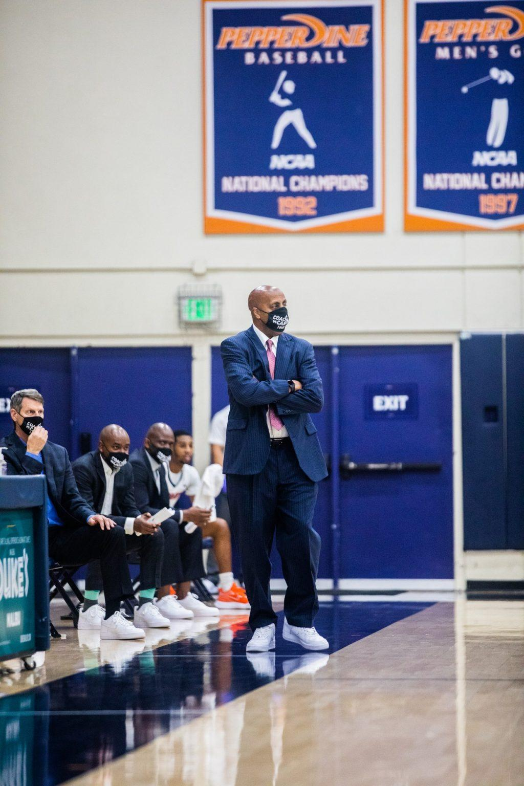 "Pepperdine Head Coach Lorenzo Romar patrols the bench during his team&squot;s loss to the Gonzaga Bulldogs. Romar said after the game that the Zags ""really could win a national championship."""