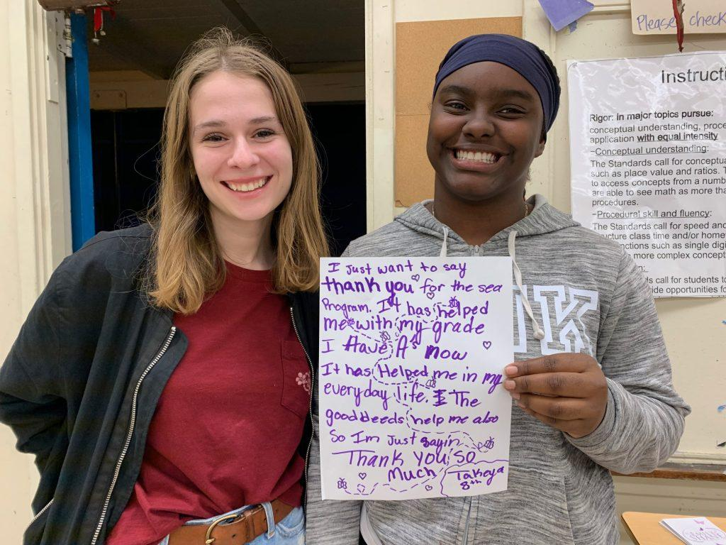 SEA tutor Zoe Clevely (left) stands with eighth grade student Takeya (right), who she tutored for one semester in Westchester, CA. Ellen Shane established many SEA affiliates outside of Malibu, including this duo.