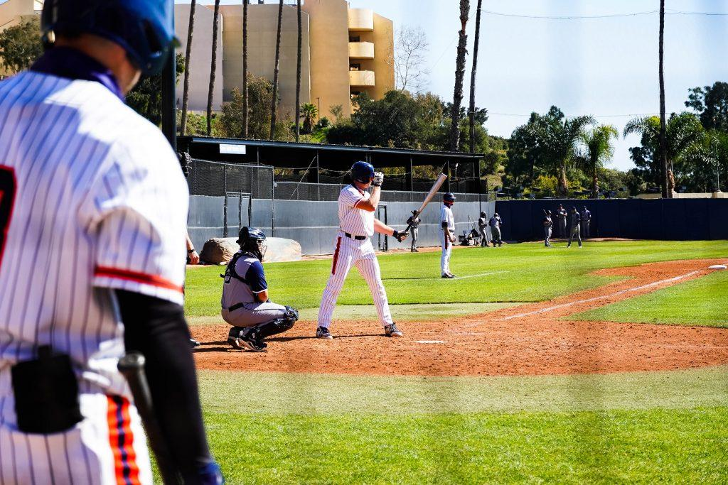 Senior center fielder Billy Cook stands ready in the batters box. Cook, who hit .344 last season with four home runs, was held without a hit in the opening series.